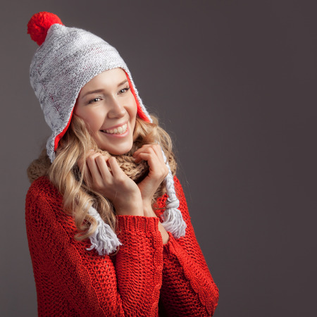 Beautiful smiling woman wearing winter clothing. photo