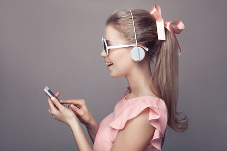 bluetooth: Girl with headphones listening music and have fun.