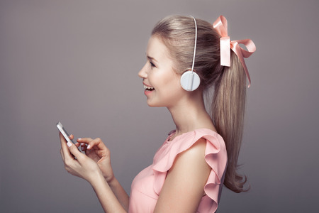 Girl with headphones listening music and have fun. photo
