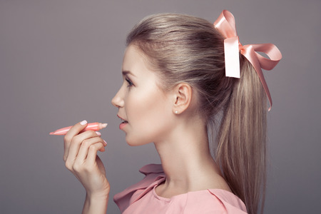 white bow: Pretty young woman with lipstick