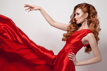 Young beautiful woman in red dress. Stock Photo