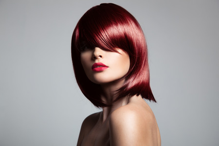 wig: Beautiful red hair model with perfect glossy hair. Close-up portrait.