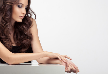 Beautiful woman taking care of her hands. Space for text. photo