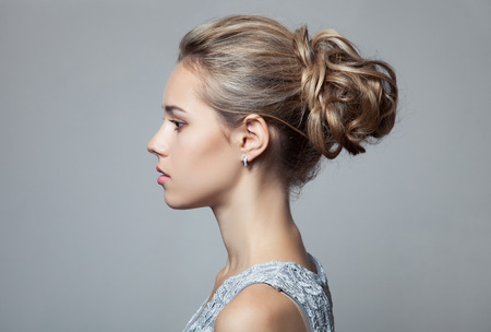 Beautiful Blond Woman. Hairstyle and Make-up. Banco de Imagens