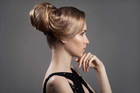 Beautiful Blond Woman. Hairstyle and Make-up. Stock Photo