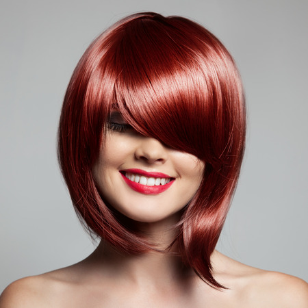 Smiling Beautiful Woman With Red Short Hair. Haircut. Hairstyle. Fringe. Фото со стока