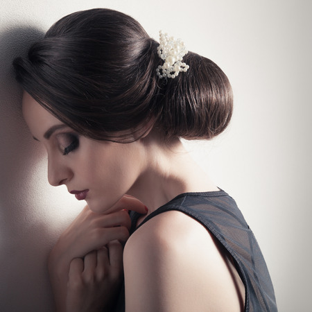 upsweep: Beautiful Woman. Fashion Festive Coiffure with Pearls. Upsweep. Hairstyle. Stock Photo