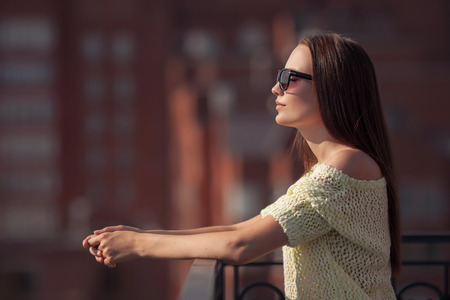 beautiful weather: Beautiful girl in sunglasses enjoying the freshness. Sunset summer.
