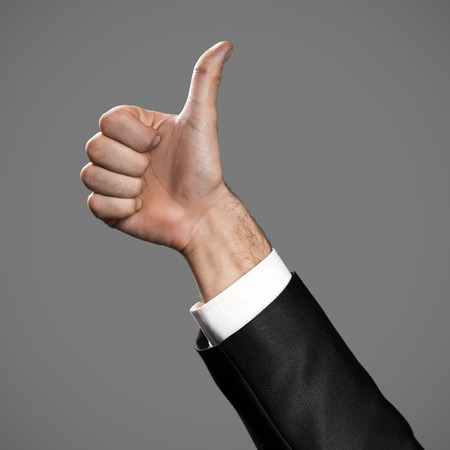 Business Mans Thumb Up Hand Sign.
