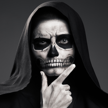 otherworldly: Scary Death Ponders Supporting His Head Arm. Realistic Skull Makeup.