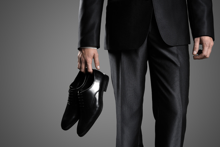 holding close: Businessman Holding The Shoes In Hand, Close Up.