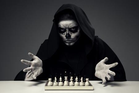 otherworldly: Concept Playing With Death. Woman In Realistic Skull Makeup Playing Chess.