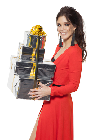 christmas isolated: Charming Woman Holding Many Gifts. Happy New Year. Marry Christmas. Isolated On White.