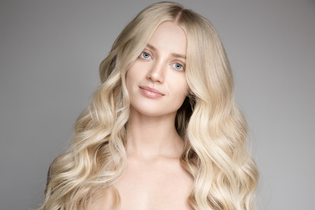 magnificent: Portrait Of Beautiful Young Blond Woman With Long Wavy Hair.