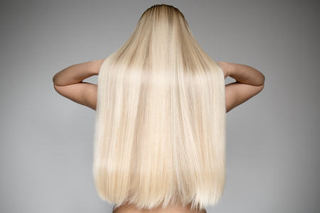 Portrait Of A Beautiful Young Blond Woman With Long Straight Hair. Back View Imagens - 66576144