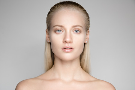 slicked: Portrait Of A Beautiful Young Blond Woman With Long Slicked Hair Stock Photo