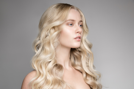 wavy: Portrait Of A Beautiful Young Blond Woman With Long Wavy Hair.