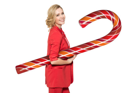 Smiling Woman Holding Big Lollypop. Happy New Year. Merry Christmas. Isolated.