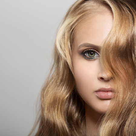 Portrait Of A Beautiful Young Blond Woman With Long Wavy Hair Stock Photo
