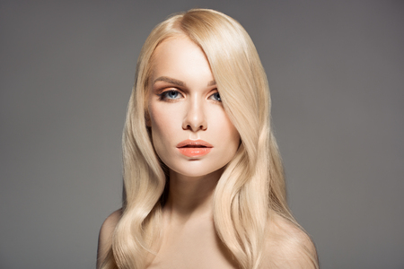 haircut: Portrait Of Beautiful Young Blond Woman With Long Wavy Hair.