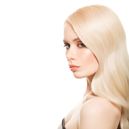 haircut: Portrait Of Beautiful Young Blond Woman With Long Wavy Hair. Isolated.