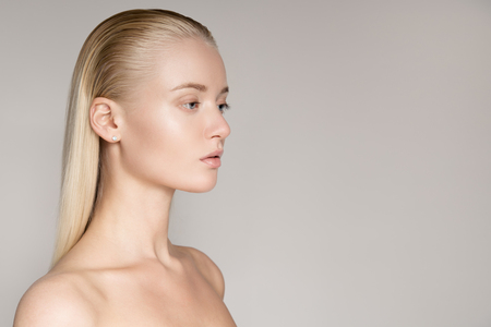 Portrait Of A Beautiful Young Blond Woman With Long Straight Hair photo