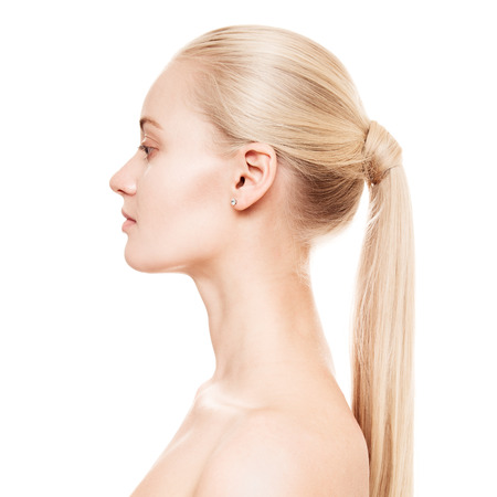 Portrait Of A Beautiful Young Blond Woman With Ponytail Hairstyle. photo