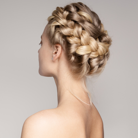 Portrait Of Beautiful Young Blond Woman With Braid Crown Hairstyle. photo