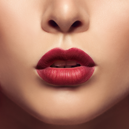 Beautiful lips close up. Red mat lipstick.