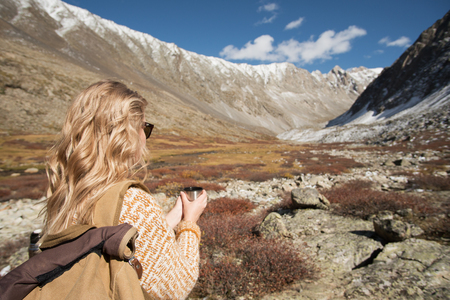 Woman backpacker trekking in mountains.