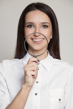 Happy attractive woman dentist doctor. 版權商用圖片