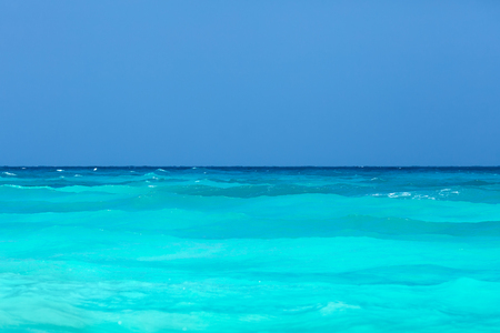 Tropical turquoise sea and clear blue sky.