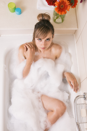 Young pretty woman relaxing in bathroom.