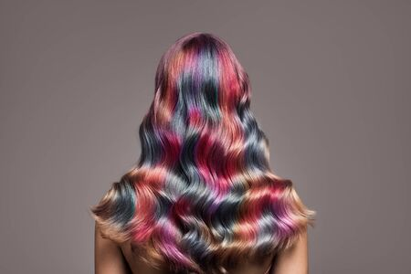 Perfect long wavy colorful hair. View from behind.