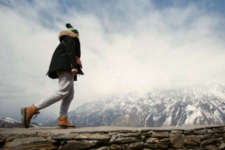Woman trekking in the Himalayan mountains Stock Photo