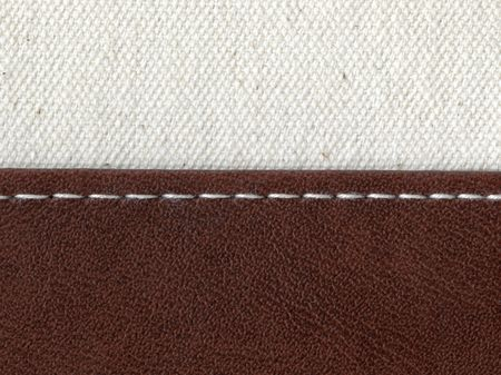 two textile materials jointed by white thread