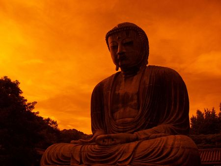 giant bronze Buddha statue in Kamakura Japan with dramatic sky background - taken with orange filter
