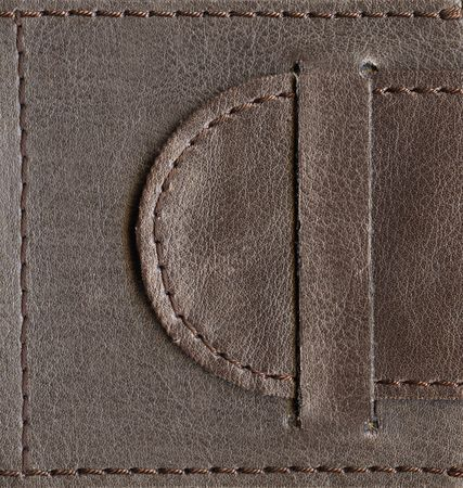 brown textured leather lock, belt stitched by thread over edges, high-resolution scan Stock Photo