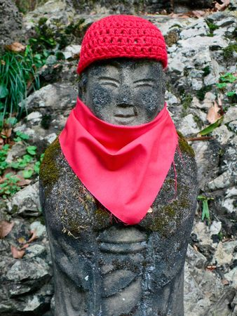 goodwill: traditional statue of japanese jizo (goodwill deity) on the forest way Stock Photo