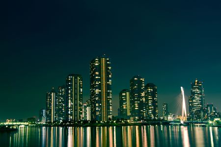cityscape of night Tokyo, modern district buildings at Tsukishima district Stok Fotoğraf