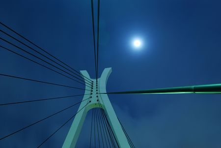 full moon and suspension bridge elements on the night city sky photo