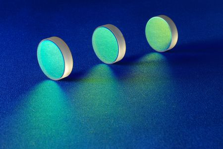 these optical components are for laser industry; flat thick mirrors with special reflection coating used in Laboratory Science and in Laser Manufacture Stock Photo - 2718245