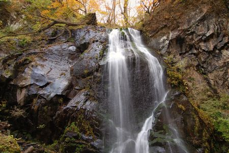 scenic cascade from Urami waterfall, Nikko, Japan at late autumn time photo