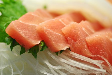 served:  macro image of served Japanese raw fish food called sasimi; focus on front pieces Stock Photo