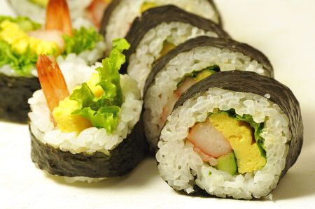 close-up shot of traditional fresh japanese sushi rolls, focus on the front piece Stock Photo