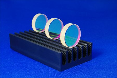 specially coated optical mirrors for laser industry and science on the black metallic rail; selective focus on front mirror photo
