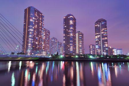 night skyscrapers cityscape in Tokyo metropolis over Sumida river waters