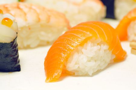 close up traditional fresh japanese sushi on white background, focus on front piece Stock Photo - 7154370