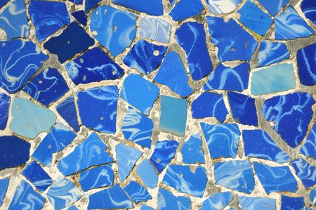 mosaic tiles: typical blue ceramic pattern from Park Guell, Barcelona, creation of Antonio Gaudi