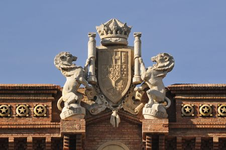 central top fragment of famous Arc de Triomf built for the 1888 Universal exhibition in Barcelona, Spain; Coat of Arms represents all Spanish provinces below a crown photo